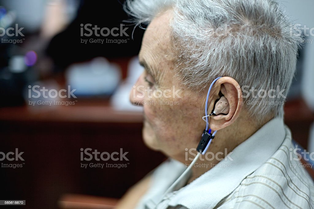 Elderly Man gettng a Hearing Test stock photo