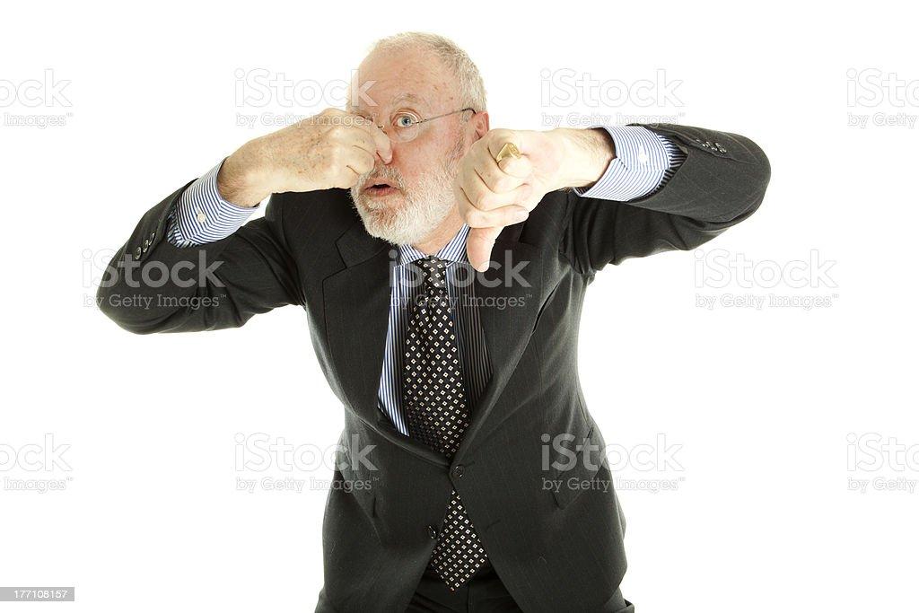 Elderly man holding his nose royalty-free stock photo
