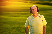 Elderly man in headphones.