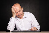 elderly man looking away thoughtfully, pondering the problem or