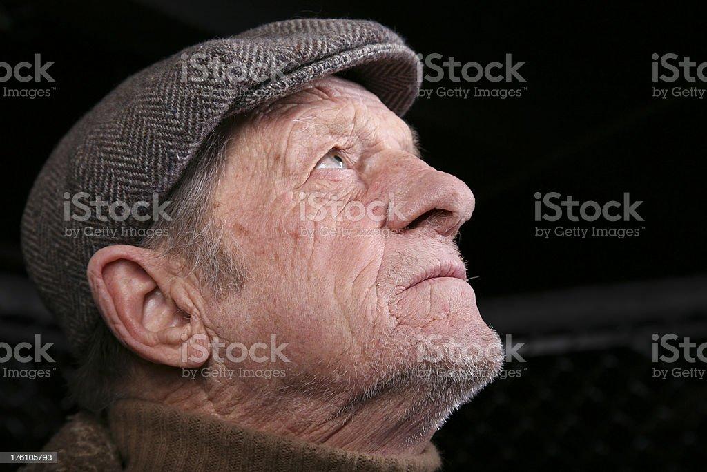 Elderly Man Looking Up for Spiritual Help stock photo
