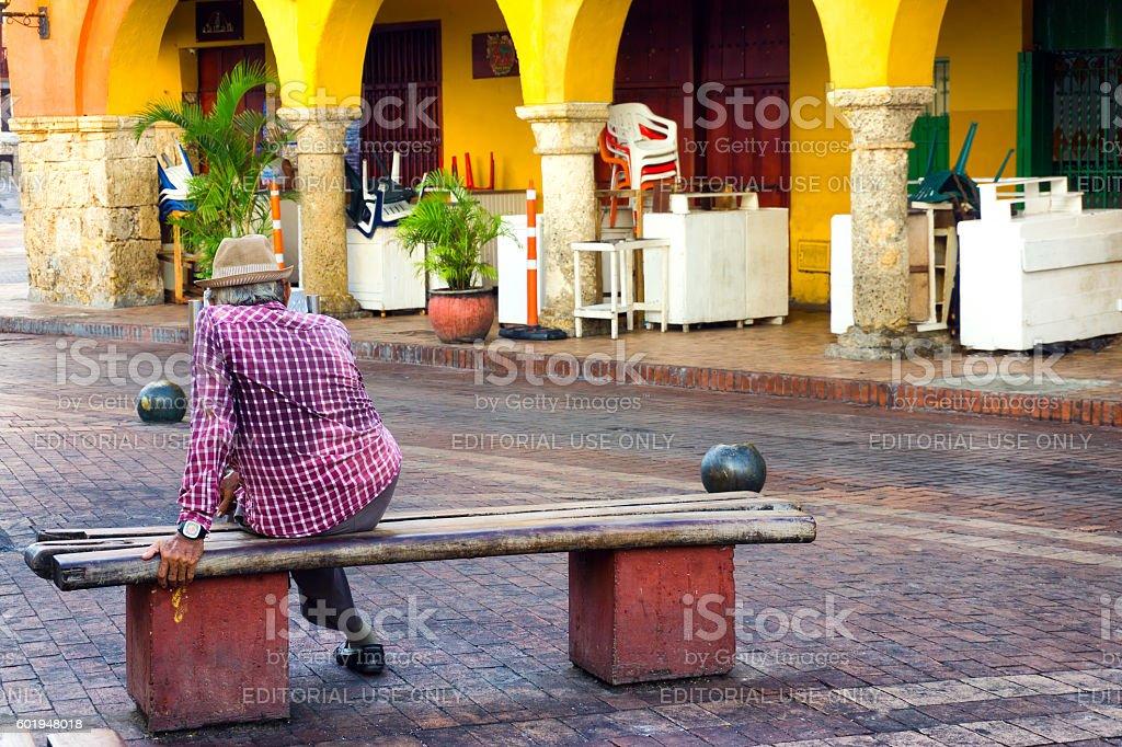 Elderly Man on a Bench stock photo