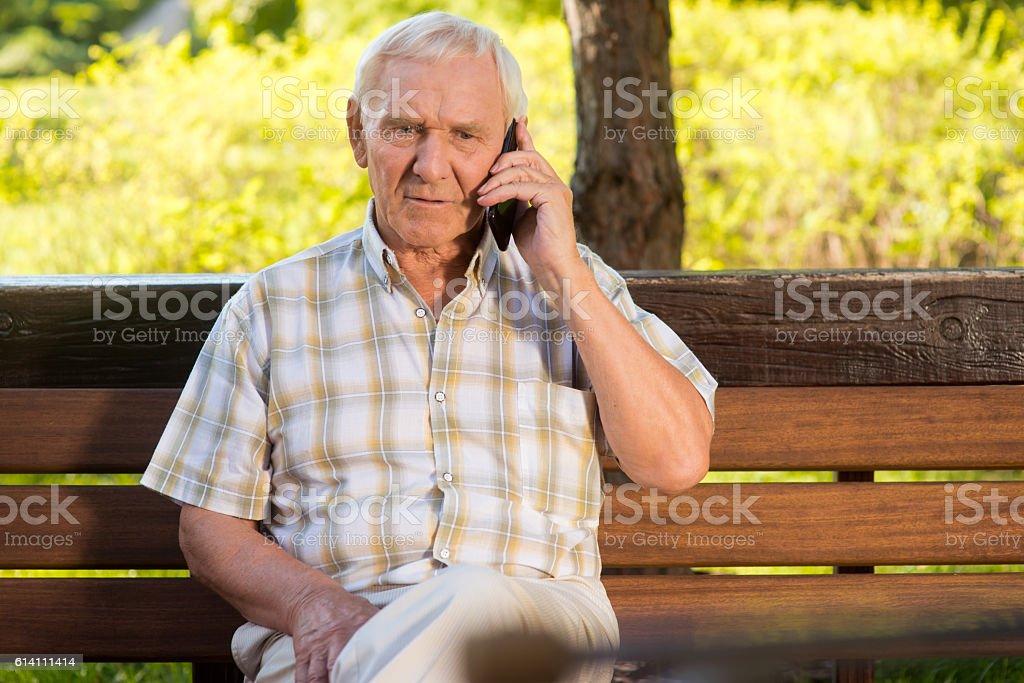 Elderly man on the phone. stock photo