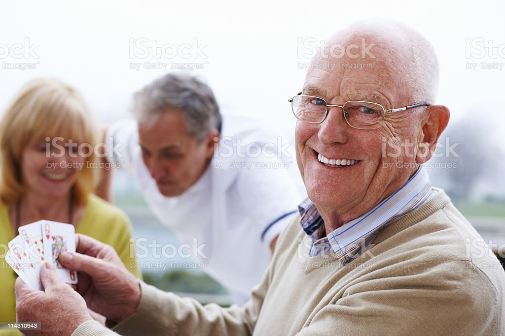 Elderly Man Playing a Card Game royalty-free stock photo
