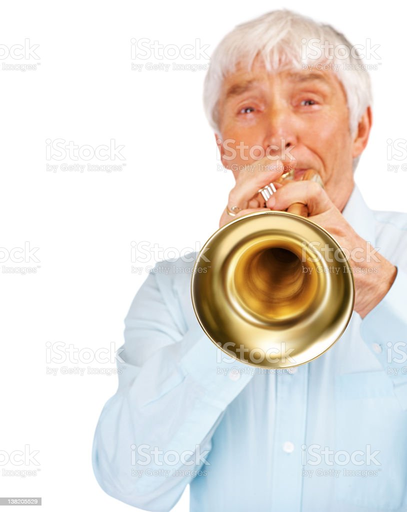Elderly man playing the trumpet against white royalty-free stock photo