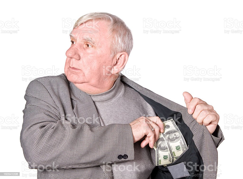 Elderly man puts money in an internal pocket royalty-free stock photo