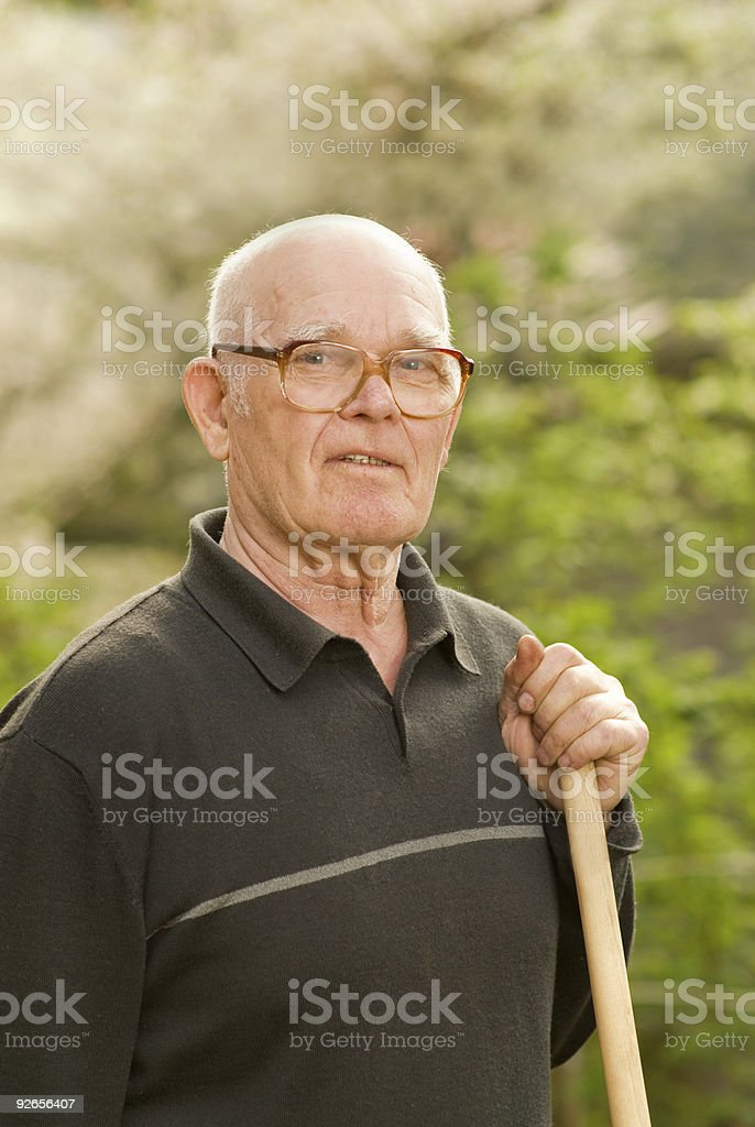 Elderly man relaxing after work in garden royalty-free stock photo