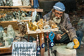 elderly man sells his art products