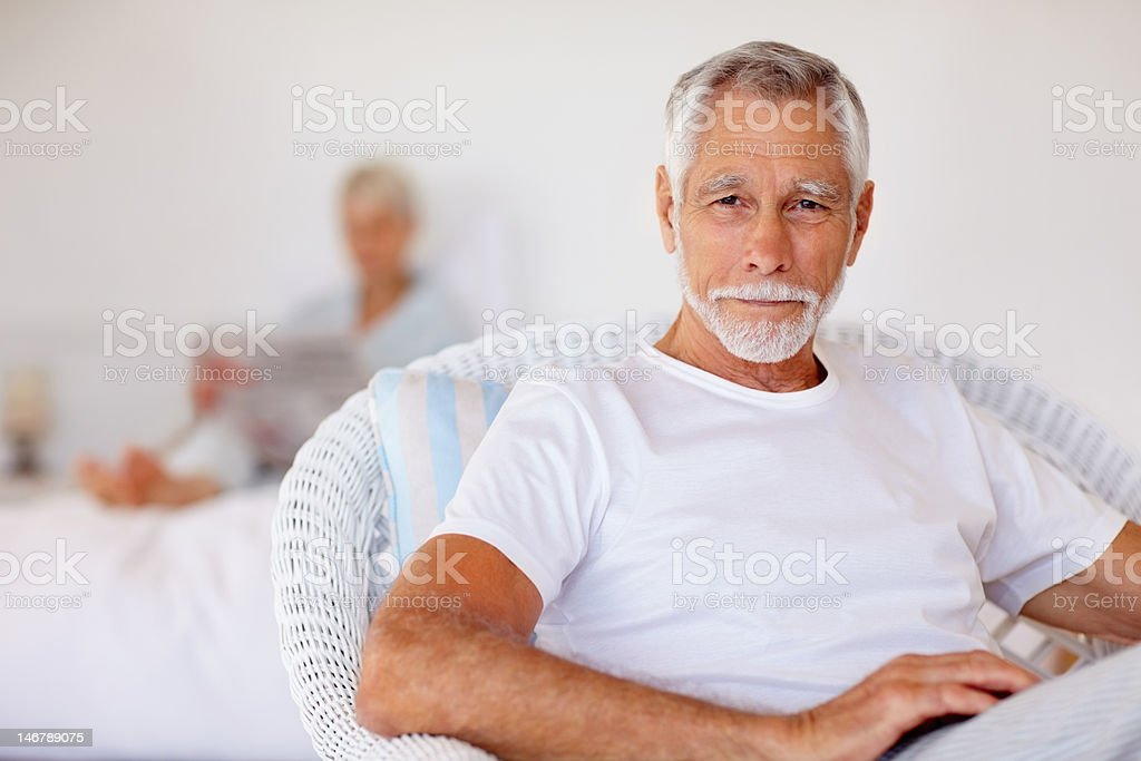 Elderly man sitting on chair royalty-free stock photo