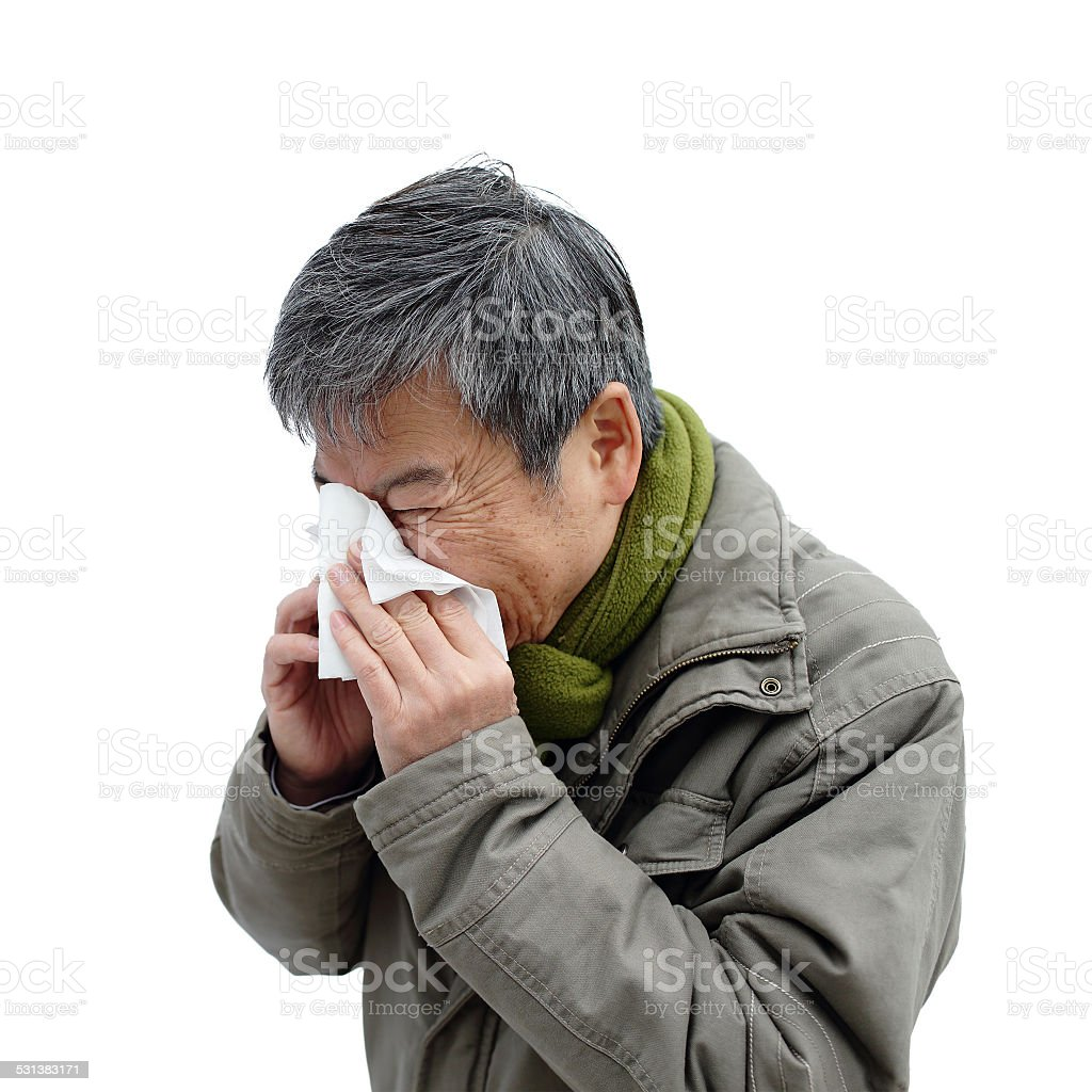 elderly man sneeze stock photo