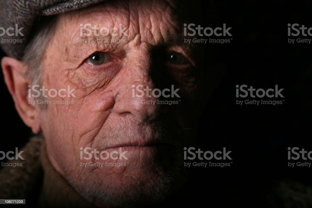 Elderly Man Stare with Dark Shadow royalty-free stock photo