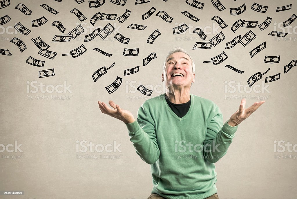 Elderly Man - trying to catch the Money, money shower stock photo