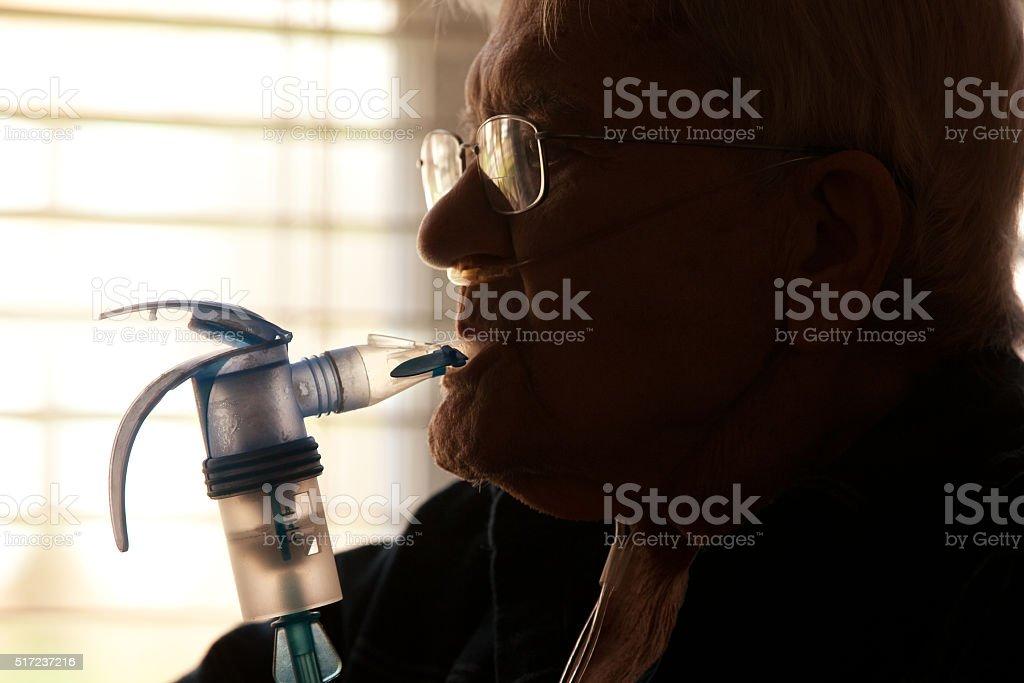 Elderly Man Using Nebulizer stock photo