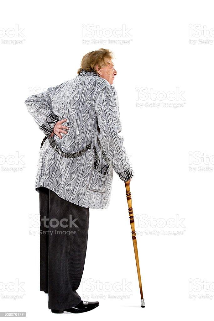 Elderly man walking with stick stock photo