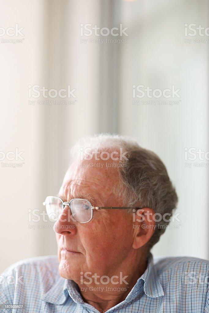 Elderly man wearing glasses looking away royalty-free stock photo