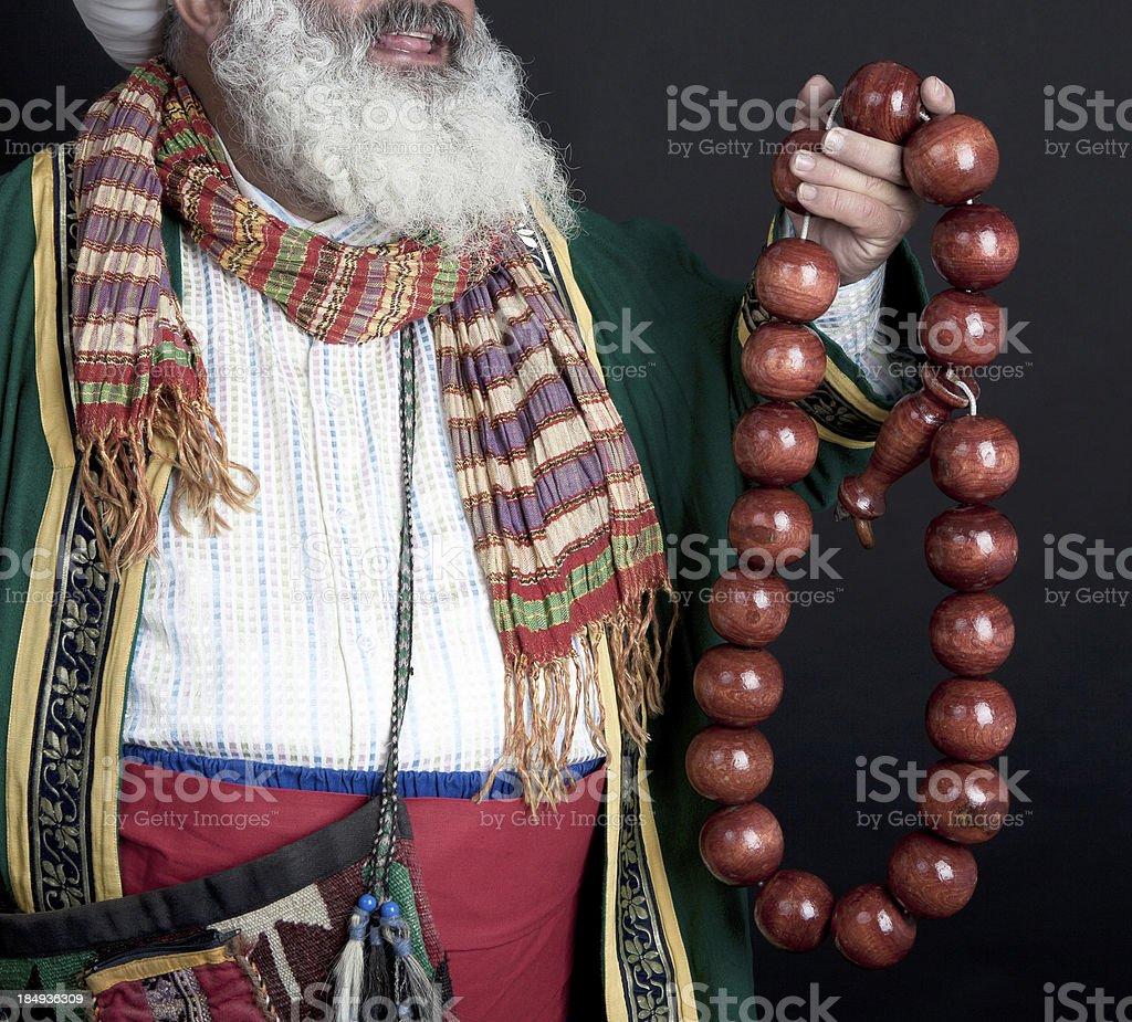 Elderly man with a prayer beads stock photo