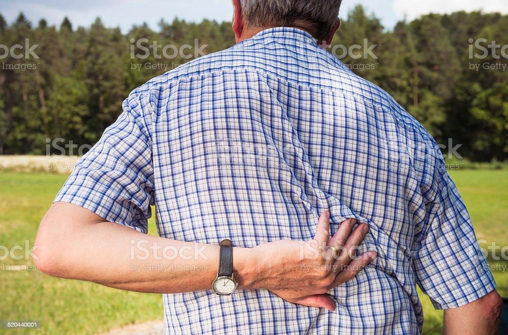 Elderly man with back pain stock photo