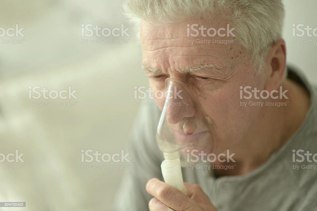 elderly man with flu inhalation stock photo