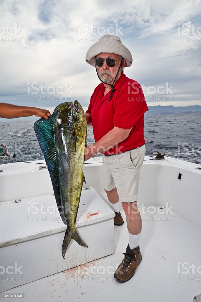 Elderly Man with Large Dorado, Mahi-Mahi or Dolphin Fish stock photo