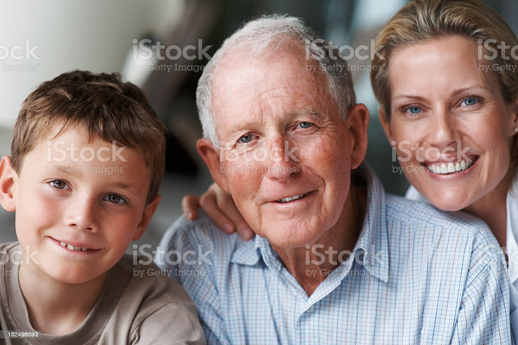Elderly man with nurse and grandson stock photo