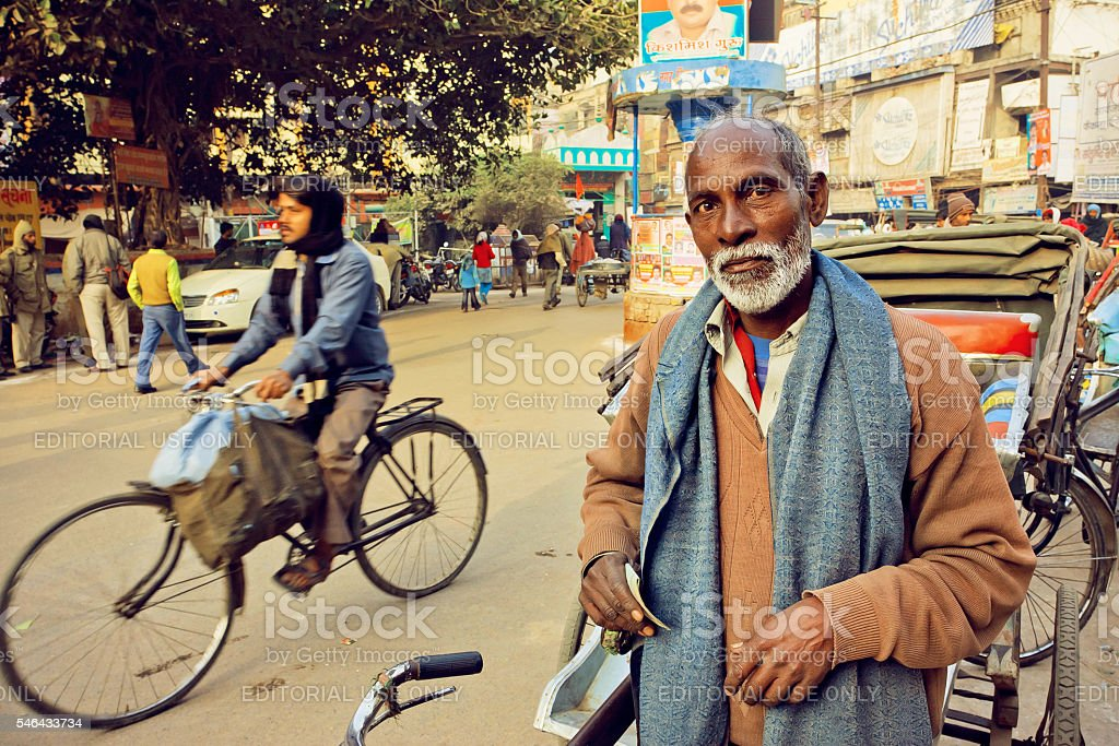 Elderly man with white beard standing on the busy street stock photo