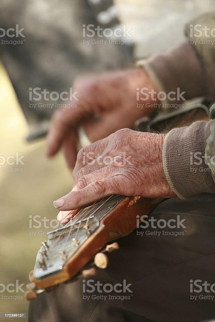 Elderly Musician Still Playing stock photo