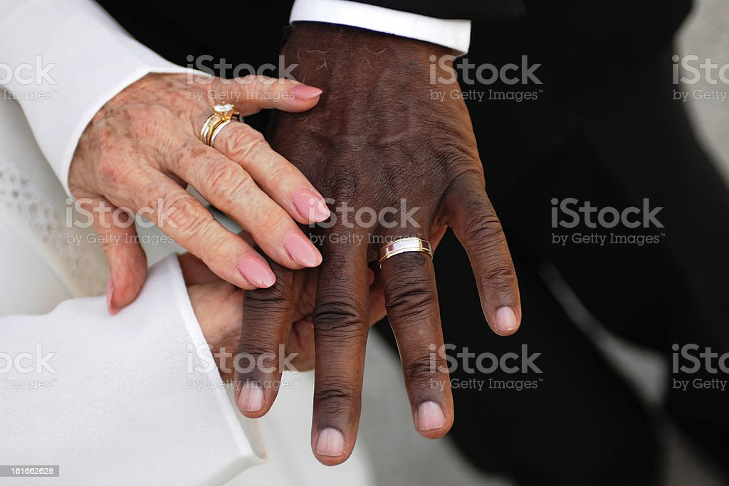 Elderly newlyweds hands and rings royalty-free stock photo