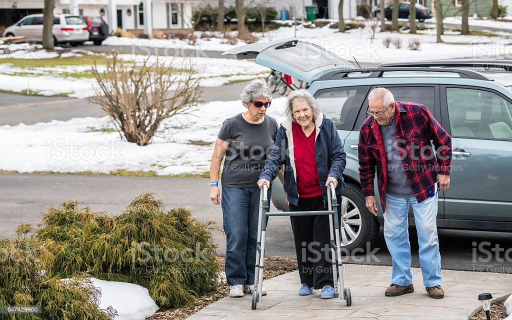 Elderly Parents and Daughter Returning Home From Hospital Emergency Room stock photo