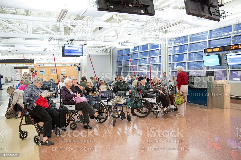Elderly passengers wait to be taken on an airplane stock photo