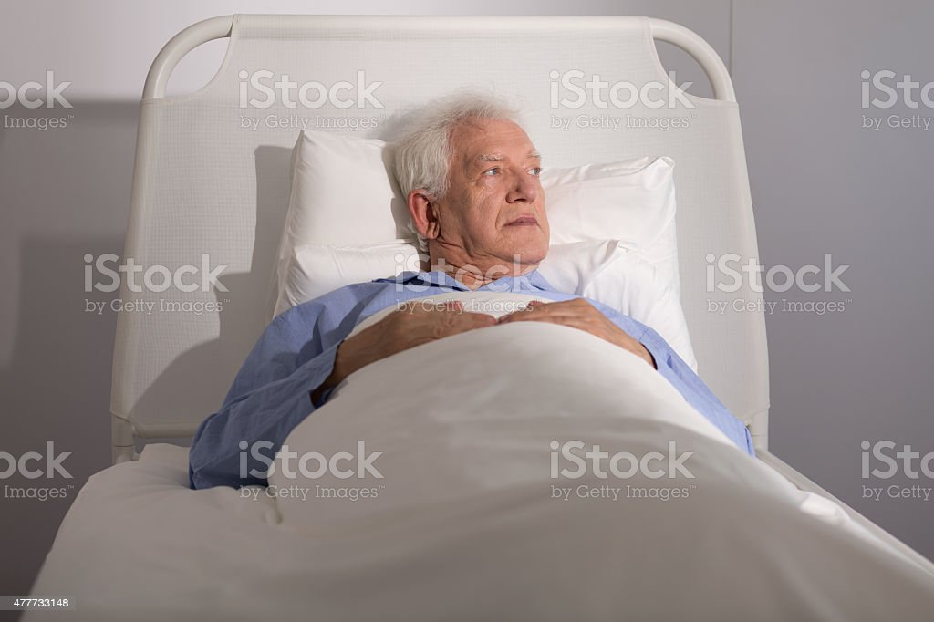 Elderly patient in bed stock photo