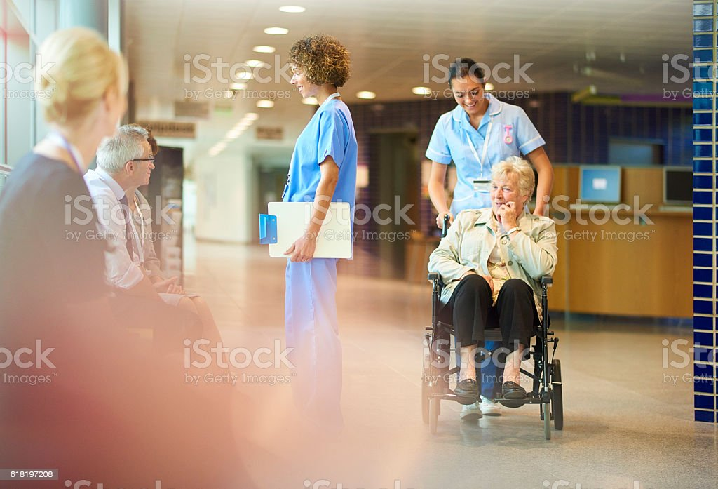 elderly patient leaves hospital stock photo