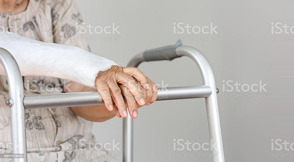 Elderly patient waiting on her walker stock photo