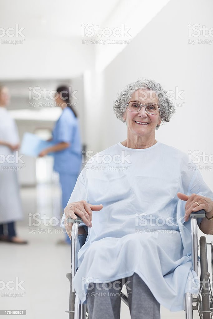 Elderly patient with wheelchair in corridor royalty-free stock photo