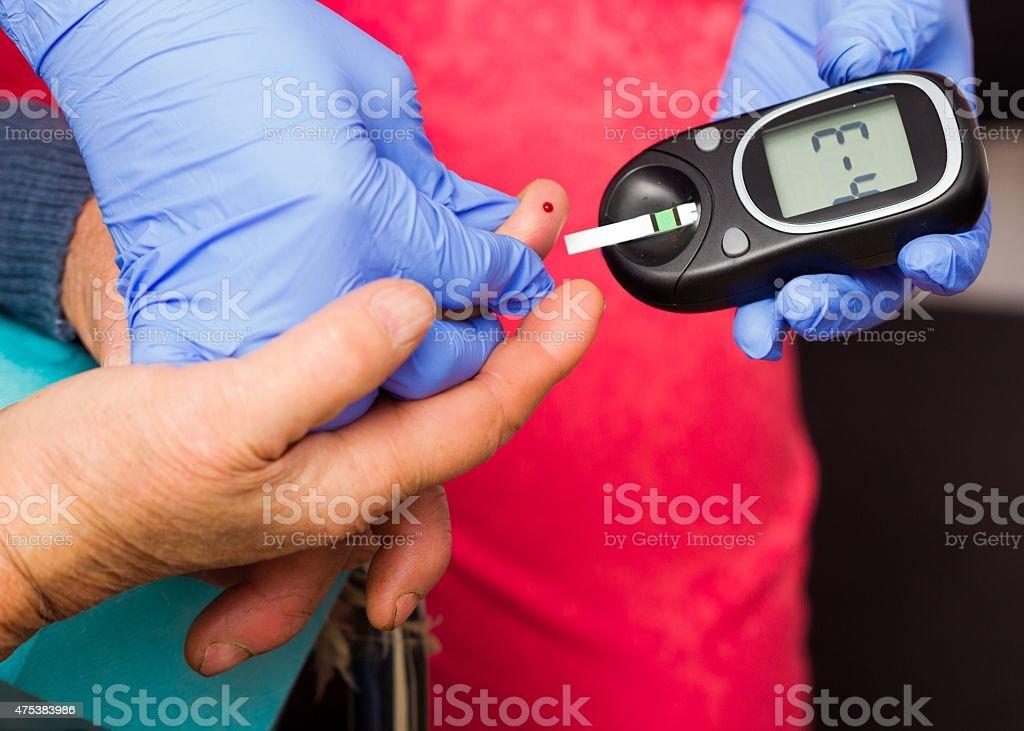 Elderly Patient's Blood Sugar Level stock photo