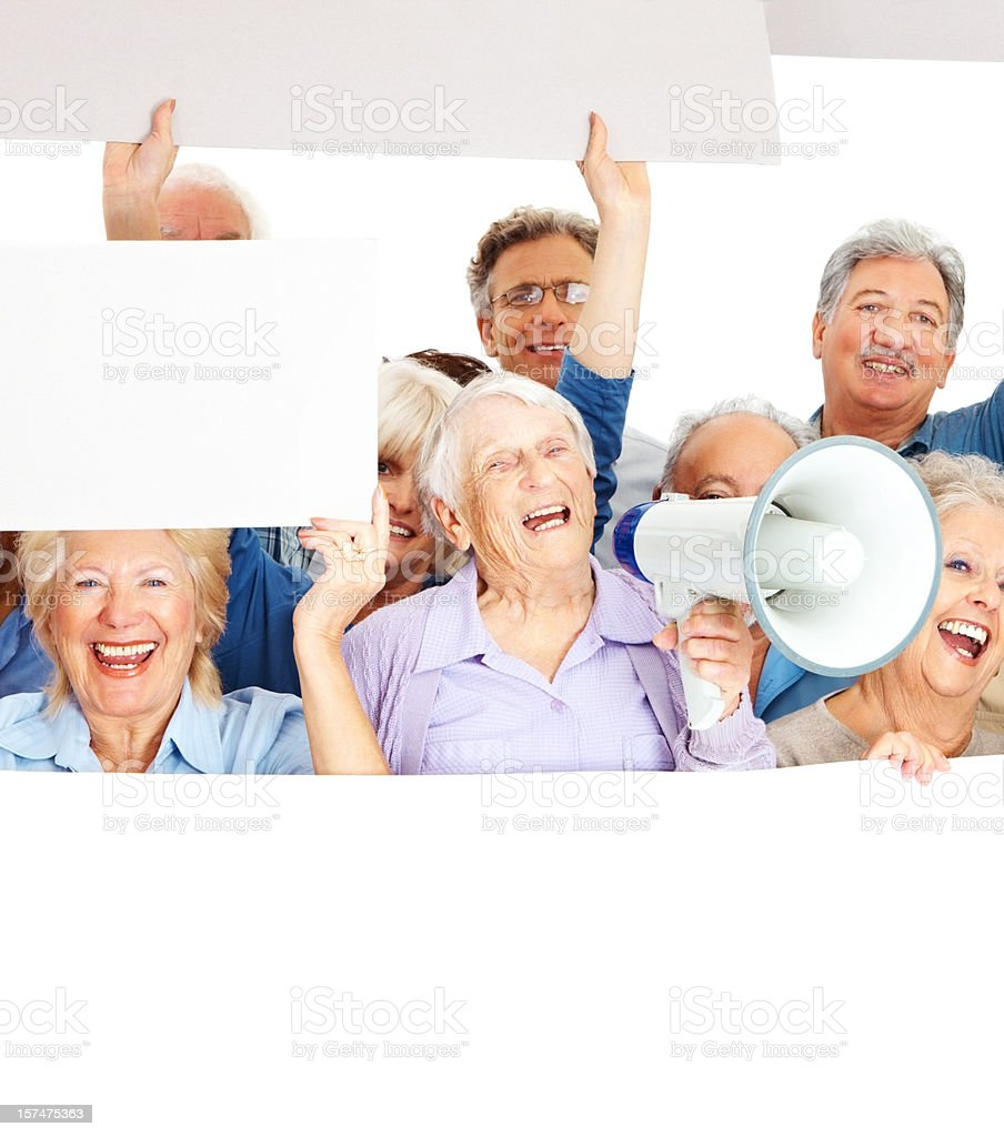 Elderly people displaying an empty board royalty-free stock photo