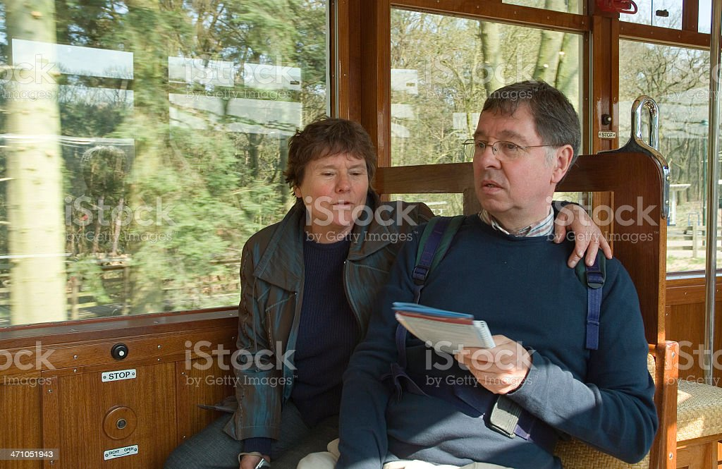 Elderly people in old tramway carriage royalty-free stock photo