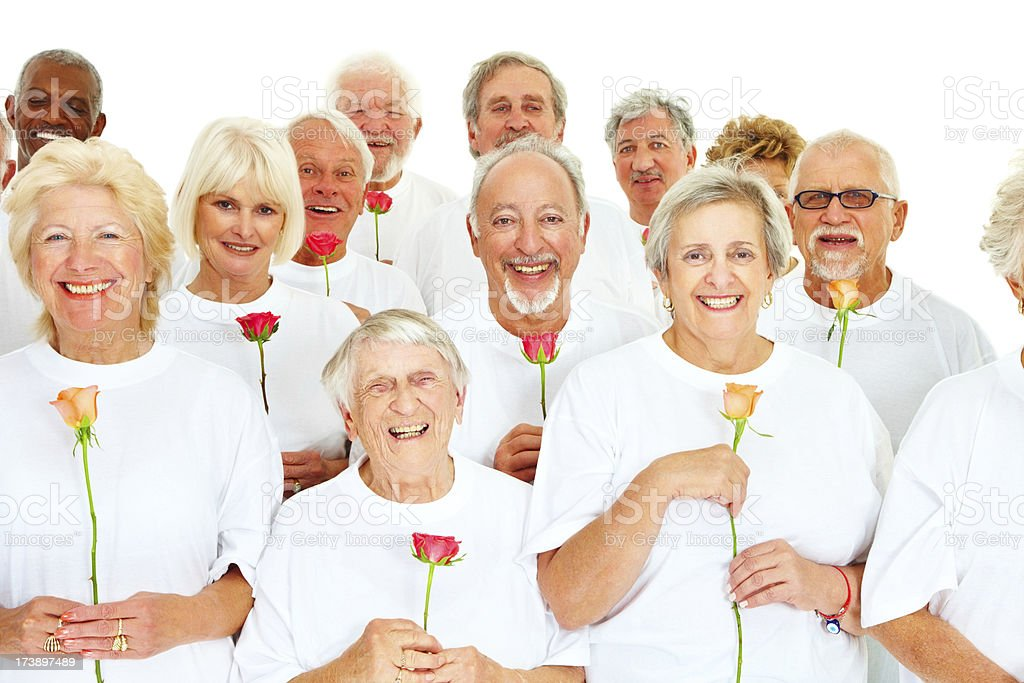 Elderly people standing together and smiling royalty-free stock photo