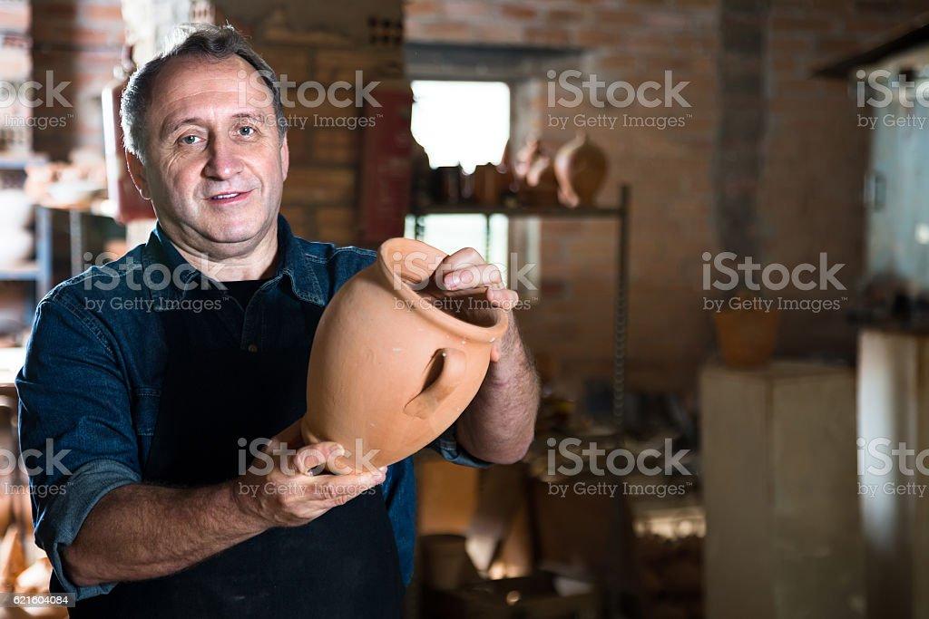 Elderly potter at ceramic workshop stock photo