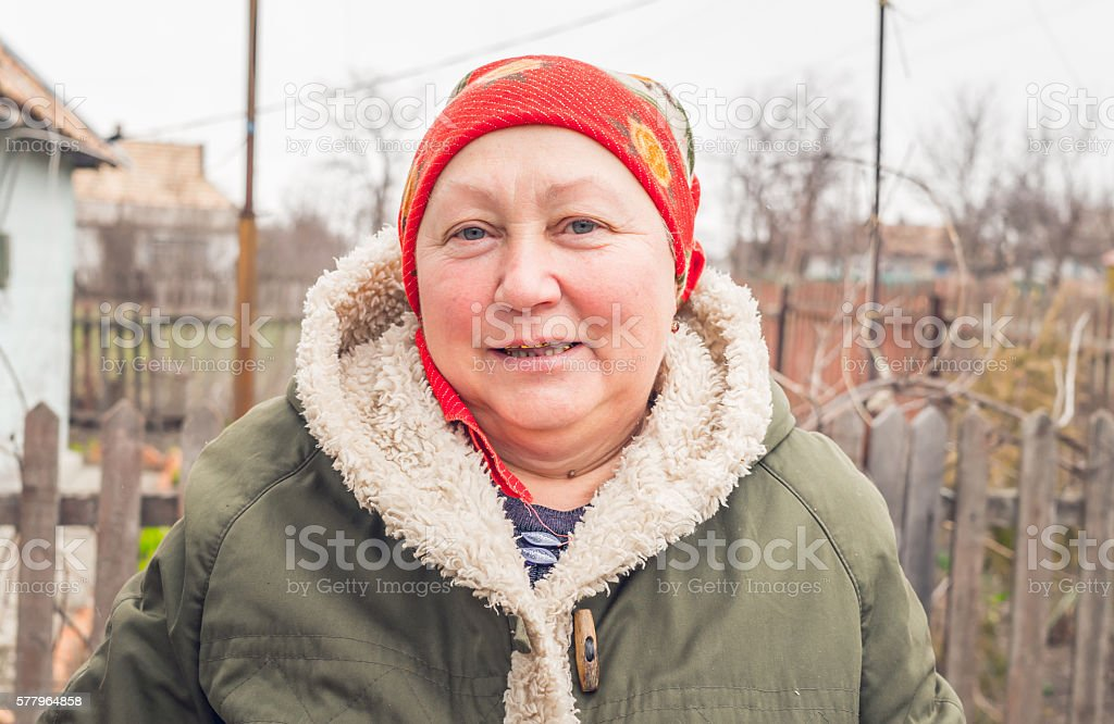 Elderly Russian woman in the village stock photo