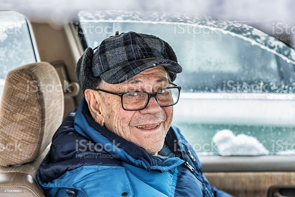 Elderly Senior Adult Driver Man in Winter Car stock photo