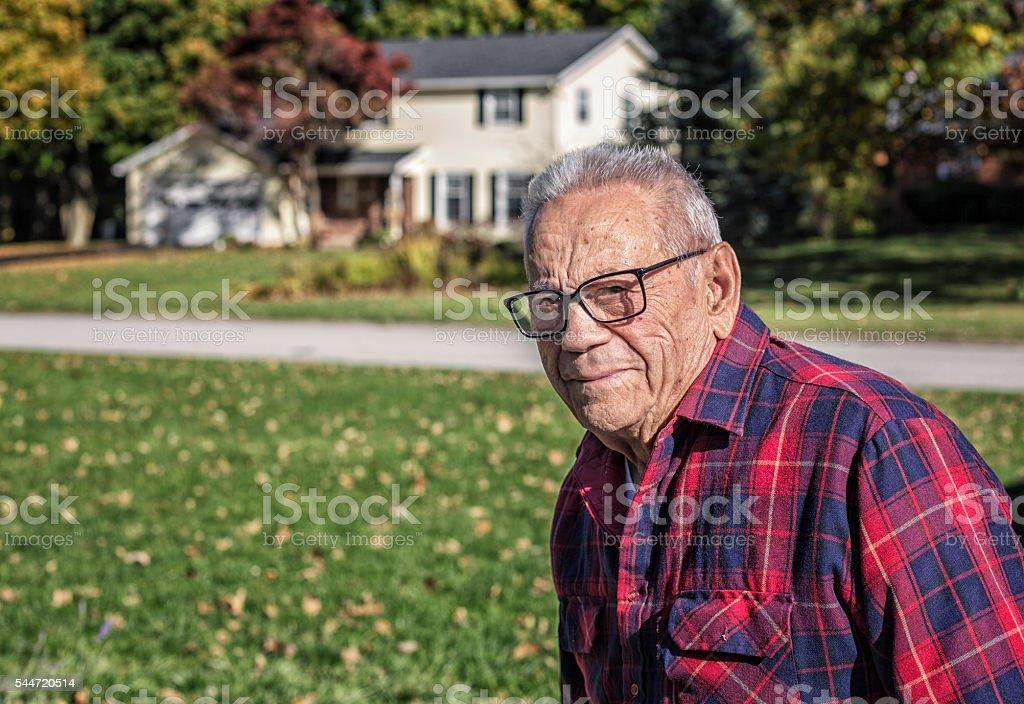 Elderly Senior Adult Man Walking Outside At Home stock photo