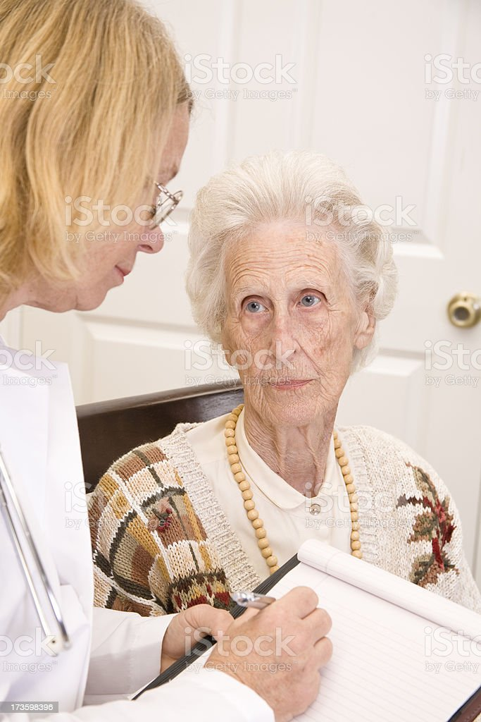 Elderly senior adult woman with doctor. Nursing home, assisted living. royalty-free stock photo
