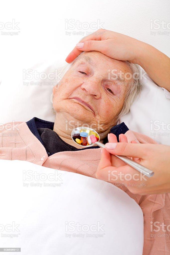 Elderly sick woman stock photo