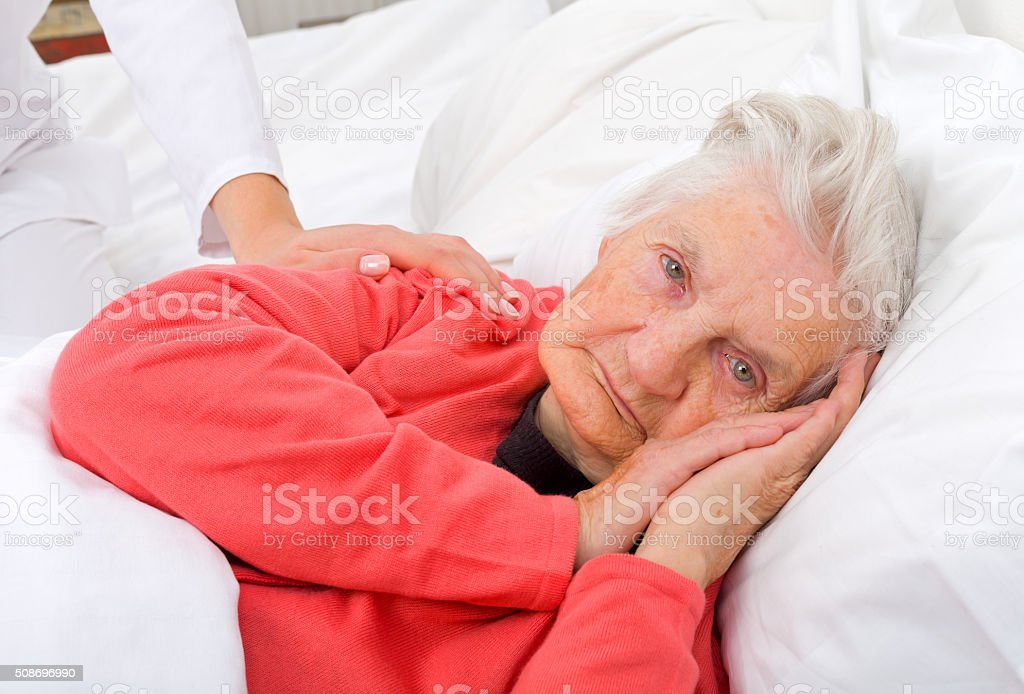 Elderly sick woman stock photo