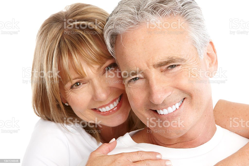 Elderly smiling couple on white background stock photo
