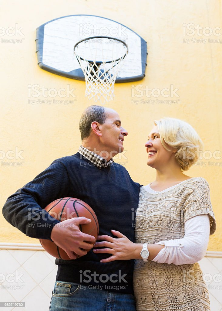 Elderly spouses throwing the ball stock photo