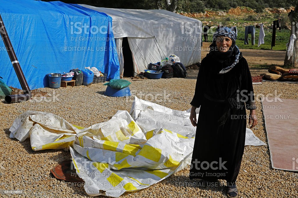 Elderly Syrian Woman in Refugee Camp stock photo