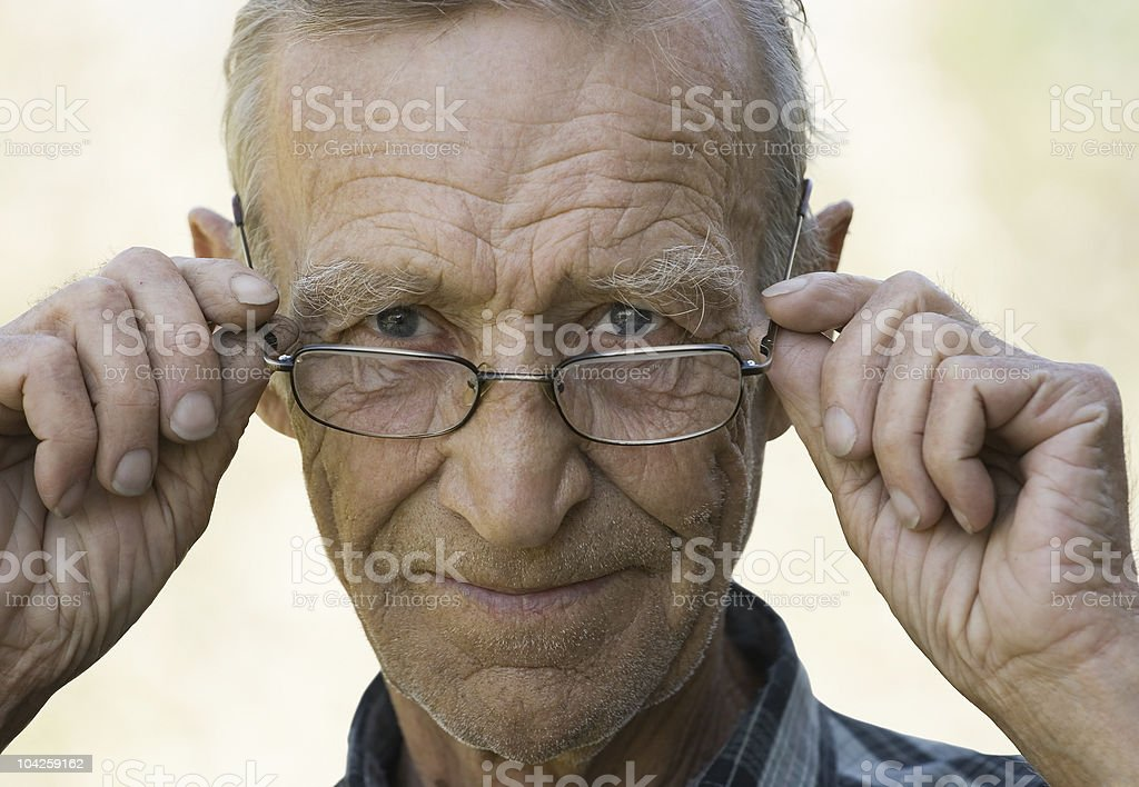 Elderly the man in glasses royalty-free stock photo