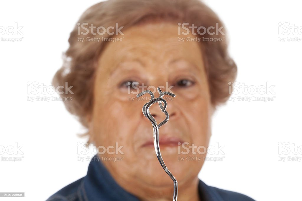 Elderly with psychokinetic abilities bend fork. stock photo