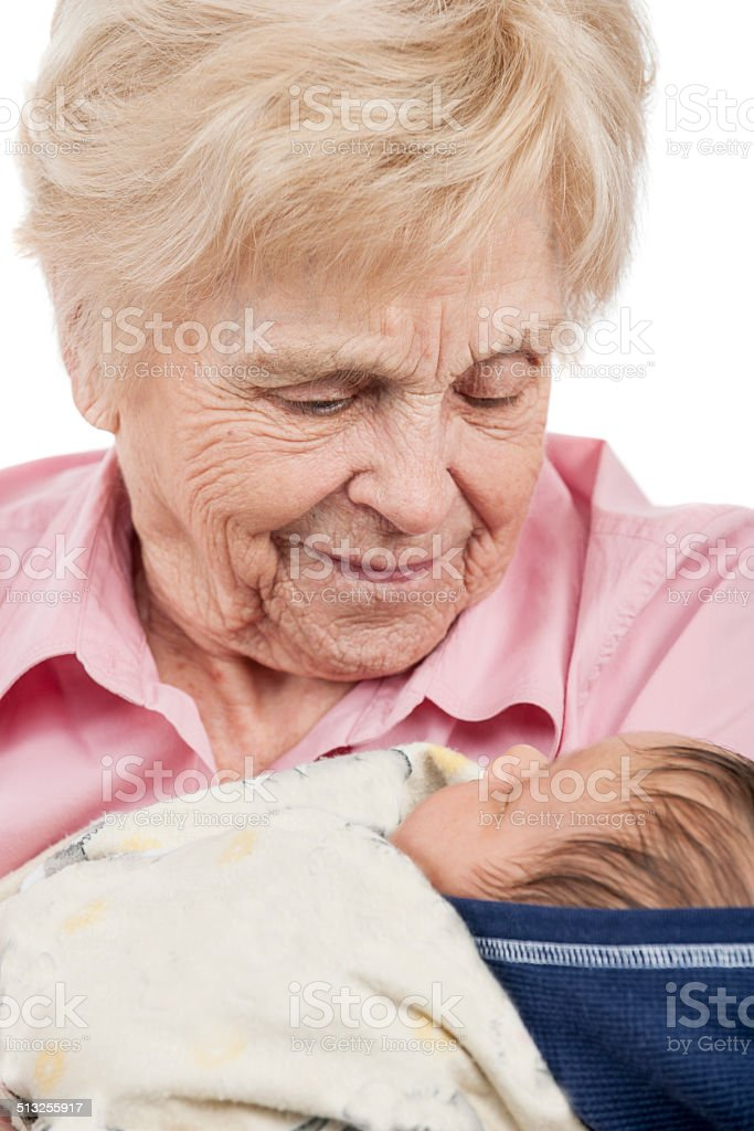 Elderly woman and infant stock photo